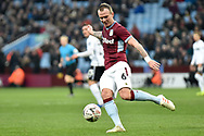 Aston Villa midfielder Glenn Whelan (6) clears his lines during the The FA Cup 3rd round match between Aston Villa and Swansea City at Villa Park, Birmingham, England on 5 January 2019.