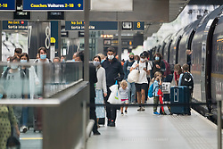 © Licensed to London News Pictures. 16/08/2020. London, UK. Passengers travelling from France arrive at the Eurostar terminal at St Pancras International after France was removed from the list of safe countries people can travel to without going into quarantine. From 4am yesterday morning (Sat) anybody returning to the UK from France will be required to self isolate for two weeks, following an increase in Covid-19 cases in France. Photo credit: Ben Cawthra/LNP