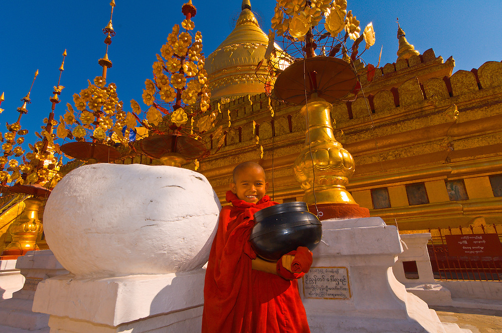 Novice monk holding alms bowl at the Shwezigon Pagoda, Bagan, Myanmar (Burma)