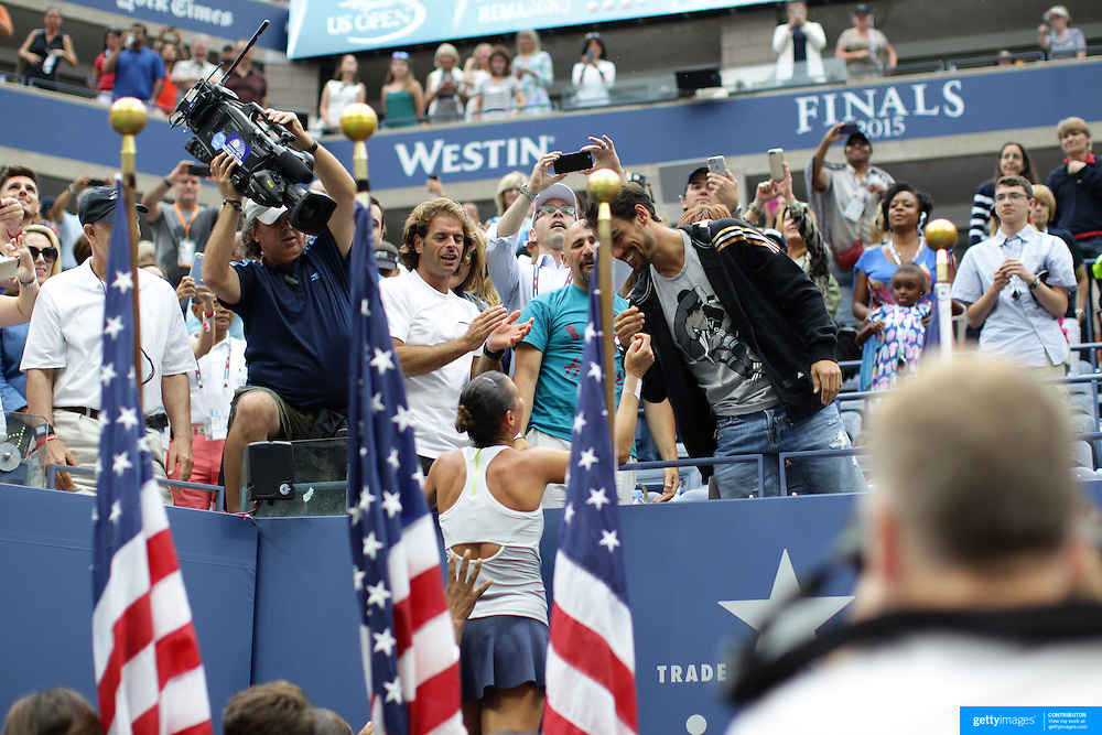 Flavia Pennetta, Italy, celebrates victory with her team after victory against Roberta Vinci Italy, in the Women's Singles Final match during the US Open Tennis Tournament, Flushing, New York, USA. 12th September 2015. Photo Tim Clayton