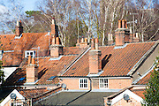 Chimney pots and pan tiled roofs in Woodbridge, Suffolk, England
