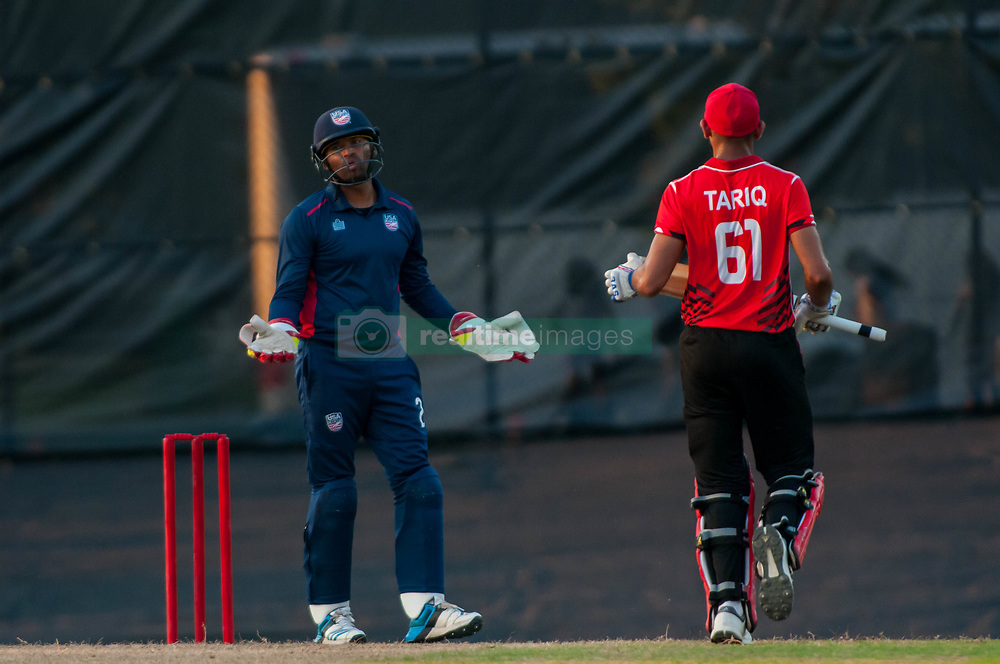 September 22, 2018 - Morrisville, North Carolina, US - Sept. 22, 2018 - Morrisville N.C., USA - Team USA MOHAMMED KHALEEL (2) makes an appeal as Team Canada HAMZA TARIQ (61) scores a run during the ICC World T20 America's ''A'' Qualifier cricket match between USA and Canada. Both teams played to a 140/8 tie with Canada winning the Super Over for the overall win. In addition to USA and Canada, the ICC World T20 America's ''A'' Qualifier also features Belize and Panama in the six-day tournament that ends Sept. 26. (Credit Image: © Timothy L. Hale/ZUMA Wire)