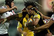 Ma'a Nonu grasped by Berrick Barnes<br /> Super 14 rugby union match, Waratahs vs Hurricanes, Sydney, Australia. <br /> Saturday 14 May 2010. Photo: Paul Seiser/PHOTOSPORT