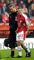 Photo: Ed Godden.<br />Bristol City v Doncaster Rovers. Coca Cola League 1. 28/10/2006. Bristol's Scott Brown leaves the pitch with an injury.