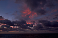 Colorful Dawn clouds over the Pacific Ocean from the deck of the MV World Odyssey. Image 6 of 6 taken with a  Fuji X-T1 camera and 23 mm f/1.4 lens (ISO 200, 23 mm, f/5.6, 1/60 sec). Raw images processed with Capture One Pro.