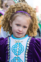 London, March 13th 2016. The annual St Patrick's Day Parade takes place in the Capital with various groups from the Irish community as well as contingents from other ethnicities taking part in a procession from Green Park to Trafalgar Square.  PICTURED: A little girl dressed in traditional Irish clothes poses for the camera. ©Paul Davey<br /> FOR LICENCING CONTACT: Paul Davey +44 (0) 7966 016 296 paul@pauldaveycreative.co.uk