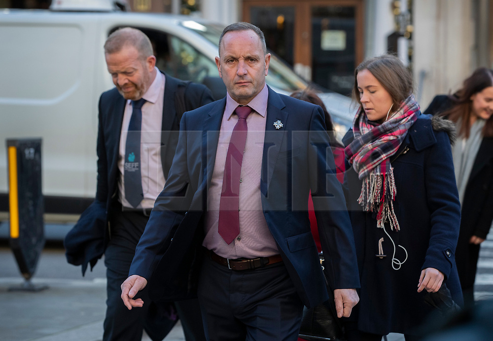 © Licensed to London News Pictures. 11/12/2019. London, UK. Mark Tipper (c),  brother of Trooper Simon Tipper - who was killed in the Hyde Park bombing in 1982, arrives at The High Court where a civil case against convicted IRA member John Downey is going ahead. A previous criminal case against Downey at The Old Bailey collapsed in 2014 after it emerged he had received a so-called 'on the run' letter dating back to 2007 as part of the Good Friday Agreement peace deal. The Hyde Park bombing in July 1982 killed Squadron Quartermaster Corporal Roy Bright, Lieutenant Anthony Daly, Lance Corporal Jeffrey Young and Trooper Simon Tipper. Photo credit: Peter Macdiarmid/LNP