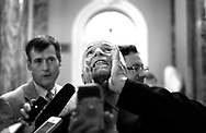 Emerging from a meeting with other senators, Senator John McCain answers questions from journalists concerning the Senate's healthcare bill in a rather dramatic manner on Capitol Hill in Washington, D.C. on June 21, 2017. (photo by Melina Mara/The Washington Post)