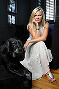 Amanda Wakeley, shoe designer and shoe addict at home with her dog.