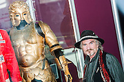 Armourer Terry English with kit he designe dfor Excalibur (Mordreds Golden Armpour). A collection of contemporary movie props, memorabilia and costumes to be auctioned on 16 October. It will include 375 items collected over 10 years and potentially worth more than £1 million. Highlights include:  Back to the Future: Part II -  Marty McFly's (Michael J. Fox) Mattel Hoverboard (estimated at £14,000 - £18,000); Willy Wonka and the Chocolate Factory - Wonka's (Gene Wilder) Golden Ticket (£15,000 - £20,000); Batman Forever – Remote control Batmobile model miniature (£20,000 - £30,000); Rush - 'Niki Lauda's (Daniel Brϋhl) Prop Ferrari 312T2 Formula One Car (£20,000 - £30,000); memorabiliaStar Wars: Return of the Jedi - Biker Scout helmet (£8,000-£10,000); and The Shining - Jack and Wendy's (Jack Nicholson & Shelly Duvall) Overlook Hotel Bed (£4,000-£6,000).