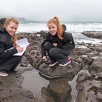Isabelle Walsh and Ellen King from Mary Immaculate Secondary School, Lisdoonvarna, studying what swims in the rock pools of North Clare