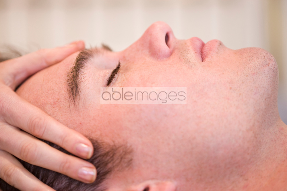 Extreme close up of a man receiving a head massage