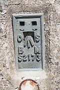 Benchmark on triangulation pillar on chalk hilltop Giant's Grave, near Oare, Wiltshire, England, UK