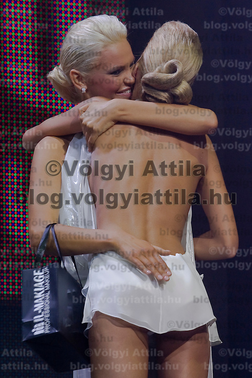 Reka Urban (left) is the winner of Miss Plastic Hungary 2009 beauty contest for beauties with surgically enhanced bodies, Budapest, Hungary. Saturday, 10. October 2009. ATTILA VOLGYI