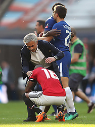 Manchester United manager Jose Mourinho (left) consoles Ashley Young after the final whistle during the Emirates FA Cup Final at Wembley Stadium, London.