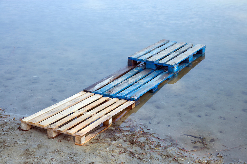 pallets placed in the water as a bridge