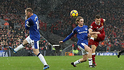 Liverpool's James Milner (right) has a shot on goal during the Premier League match at Anfield, Liverpool.