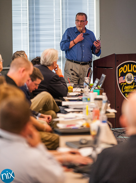 Assistant City Manager Merl Hamilton addresses the council during the city's annual planning session at the Concord Police Headquarters Friday afternoon.