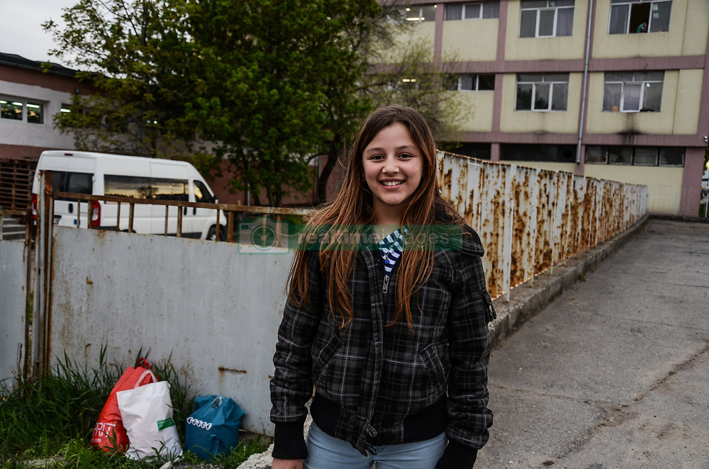 May 3, 2019 - Sofia, Bulgaria - Lina, 13, poses for a portrait in front of the refugee camp in Vrazhdebna district, Sofia. She and other children will greet Pope Francis on May 6th with songs in Bulgarian during his visit to the refugee camp where the young Algerian has been living with her family for three years Sofia, Bulgaria on May 03, 2019  (Credit Image: © Hristo Rusev/NurPhoto via ZUMA Press)