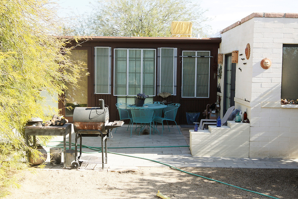 The backyard of the home of Jared Lee Loughner, 22, who is accused of killing six people dead and wounding 13 others in Tucson, Arizona January 10, 2011. Neighbors said Loughner drove the Nova.  REUTERS/Rick Wilking (UNITED STATES)