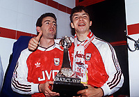 Arsenal Players celebrate their Championship title. Nigel Winterburn (left) and David Hillier. Arsenal v Manchester United.6/5/91. 1990 / 91 season. Credit : Colorsport