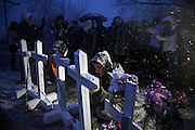 Mourners gather near crosses bearing the names of the four teenage victims of a car crash Tuesday, March 12, 2013 on Ballou Road over Forked Creek in Wesley Township, near Wilmington, in Will County. (Brian Cassella/Chicago Tribune)  B582779038Z.1 <br /> ....OUTSIDE TRIBUNE CO.- NO MAGS,  NO SALES, NO INTERNET, NO TV, CHICAGO OUT, NO DIGITAL MANIPULATION...