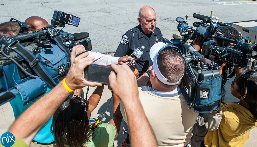 Kannapolis Police Chief Woody Chavs speaks to the media after Alisha Nicole Carlisle and John Travis Turner were taken into custody and charged in connection with the death of Malaya Heun. The two are charged with first degree murder, felony child abuse and assault with a deadly weapon.