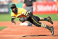 PITTSBURGH, PA - JUNE 12:  Josh Harrison #5 of the Pittsburgh Pirates makes a diving throw over to first base during the third inning against the St. Louis Cardinals on June 12, 2016 at PNC Park in Pittsburgh, Pennsylvania.  (Photo by Joe Sargent/Getty Images) *** Local Caption ***