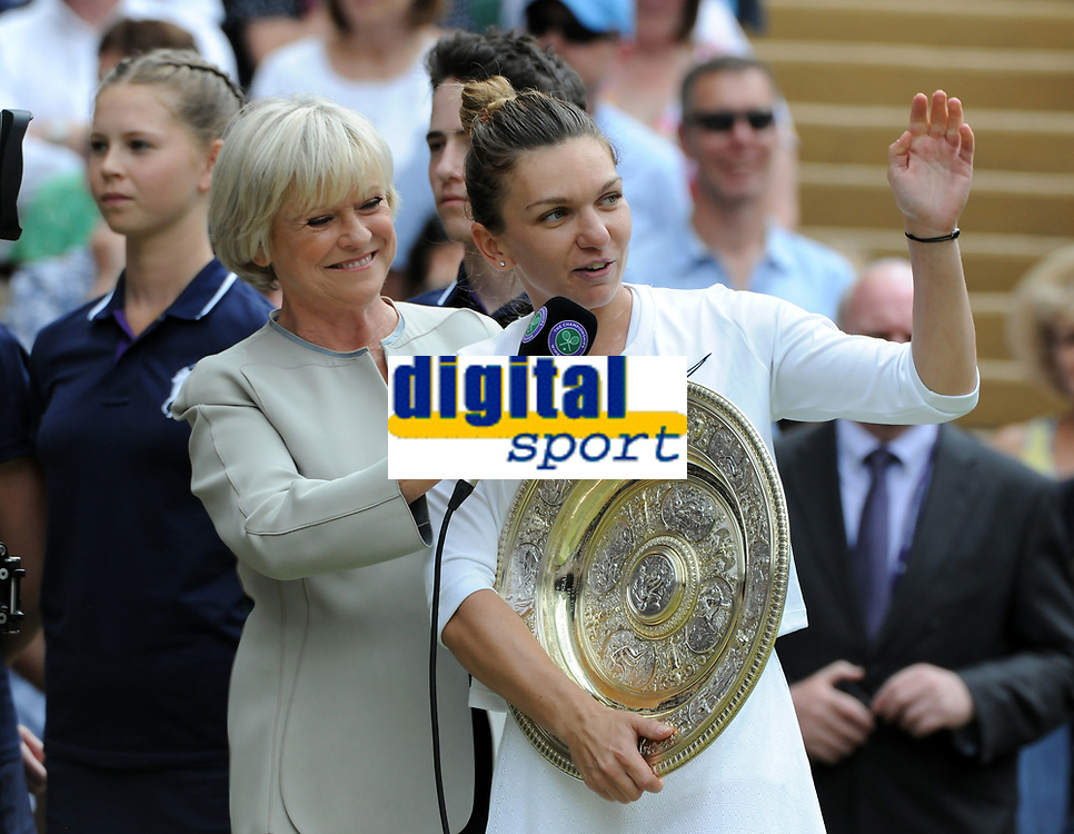 Tennis - 2019 Wimbledon Championships - Week Two, Saturday (Day Twelve)<br /> <br /> Women's Singles, Final: Serena Williams (USA) vs. Simona Halep (ROU)<br /> <br /> Simona Halep talks to Sue Barker after the match with the Shield, on Centre Court.<br /> <br /> COLORSPORT/ANDREW COWIE