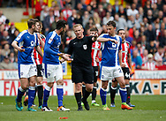 Referee John Busby issues a red card during the English League One match at  Bramall Lane Stadium, Sheffield. Picture date: April 30th 2017. Pic credit should read: Simon Bellis/Sportimage