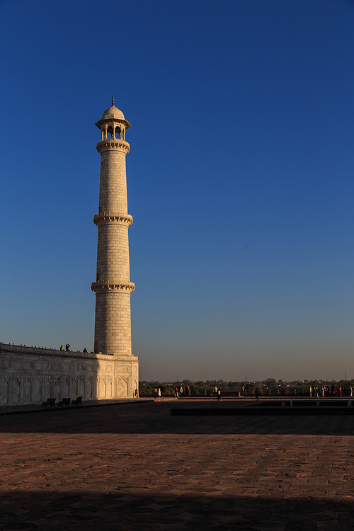 A minaret in Taj Mahal in Agra, India. The minarets was constructed slightly out of plumb to the outside of the plinth, so that in the event of collapse (a typical occurrence with many such tall constructions of the period) the structure would fall away from the tomb.
