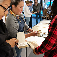 Members of gallupARTS enjoyed a unique opportunity to go through artist B. Emerson Kitsman sketch books and diaries at the Members Appreciation Night on October 10, 2019 in Gallup.