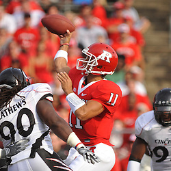 Sep 7, 2009; Piscataway, NJ, USA; Rutgers quarterback Domenic Natale (11) makes a pass in heavy pressure during the first half of Rutgers' 47-15 loss to Cincinnati in NCAA college football at Rutgers Stadium.