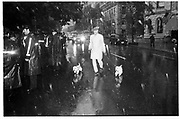 George Whipple, walking dogs in the rain down 5th Avenue 1992© Copyright Photograph by Dafydd Jones 66 Stockwell Park Rd. London SW9 0DA Tel 020 7733 0108 www.dafjones.com