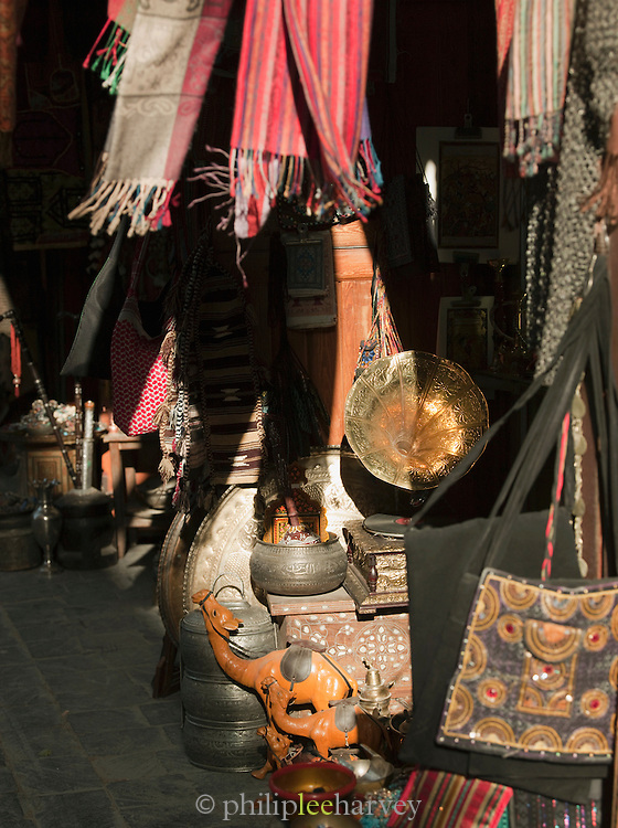 Metal works and fabric for sale in a souq of the Old City in Damascus, Syria