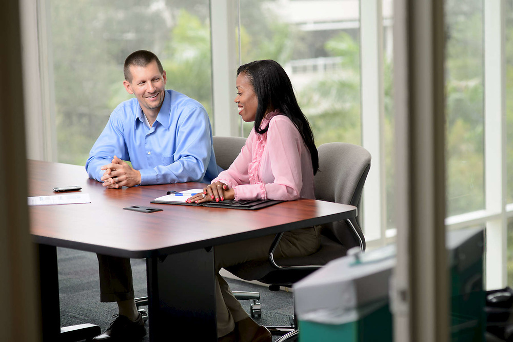 Employee Manager Interaction inside a Conference Room at a Corporate Office.