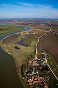 Nederland, Limburg, Gemeente Echt-Susteren, 07-03-2010; Visserweert: de stroomgeul van de Maas (Grensmaas) wordt verbreed en ten oosten van het dorp komt een nevengeul zodat de Maas (bij hoogwater) rond het dorp zal stromen. Werkzaamheden in het kader van het project Grensmaas (rivierbeveiliging door stroomgeulverbreding en oeververlaging, natuurontwikkeling en ontgrinding).Visserweert: flow channel of the Maas (Meuse) is widened and east of the village a secondary channel will be made so that the Meuse (at high water) will flow around the village. Project Border Meuse (river protection through stream channel widening and bank reduction, habitat and 'de-gravelisation').luchtfoto (toeslag), aerial photo (additional fee required).foto/photo Siebe Swart
