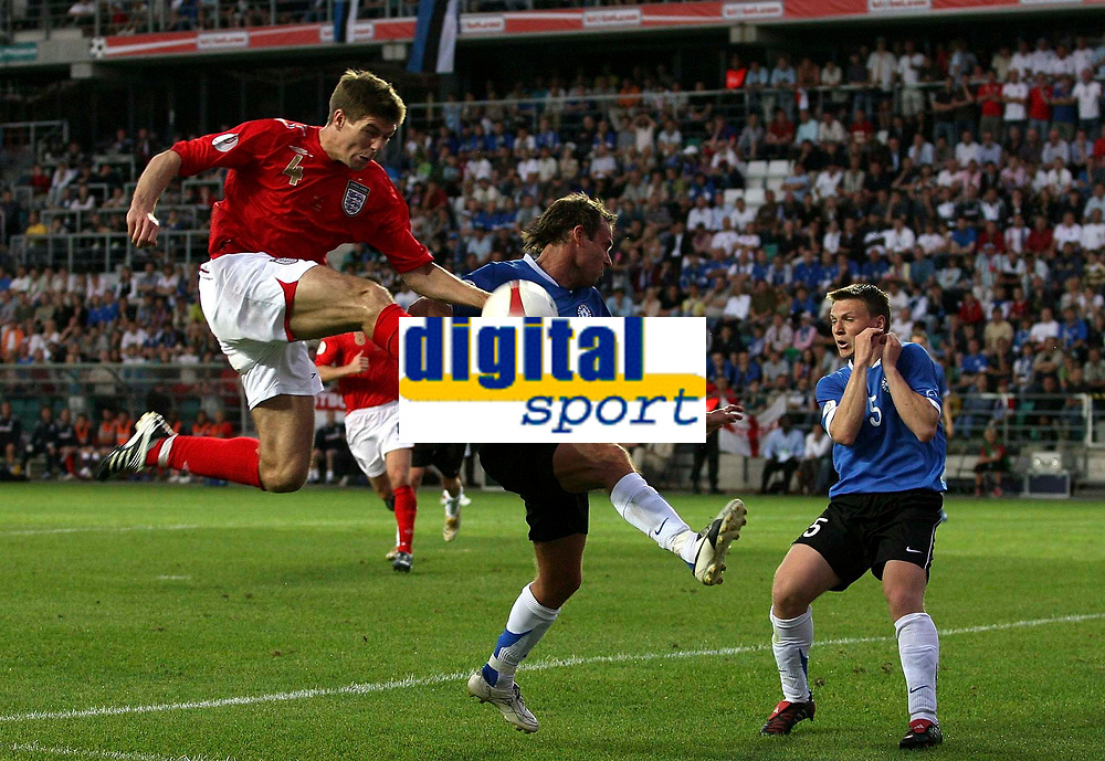 Photo: Paul Thomas.<br /> Estonia v England. UEFA European Championships Qualifying, Group E. 06/06/2007.<br /> <br /> Steven Gerrard (L) of England jumps to win the ball from the Estonia defence.