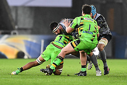Ospreys' Scott Baldwin is tackled by Northampton Saints' Lewis Ludlam<br /> <br /> Photographer Craig Thomas/Replay Images<br /> <br /> EPCR Champions Cup Round 4 - Ospreys v Northampton Saints - Sunday 17th December 2017 - Parc y Scarlets - Llanelli<br /> <br /> World Copyright © 2017 Replay Images. All rights reserved. info@replayimages.co.uk - www.replayimages.co.uk