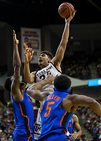Texas A&M center Tyler Davis (34) puts up a shot against Florida forward Kevarrius Hayes (13) during the first half of an NCAA college basketball game Tuesday, Jan. 2, 2018, in College Station, Texas. (AP Photo/Sam Craft)