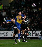 Photo: Steve Bond.<br />Notts County v Hereford United. Coca Cola League 2. 02/10/2007. Steve Guinan (L) v Adam Tann (R)