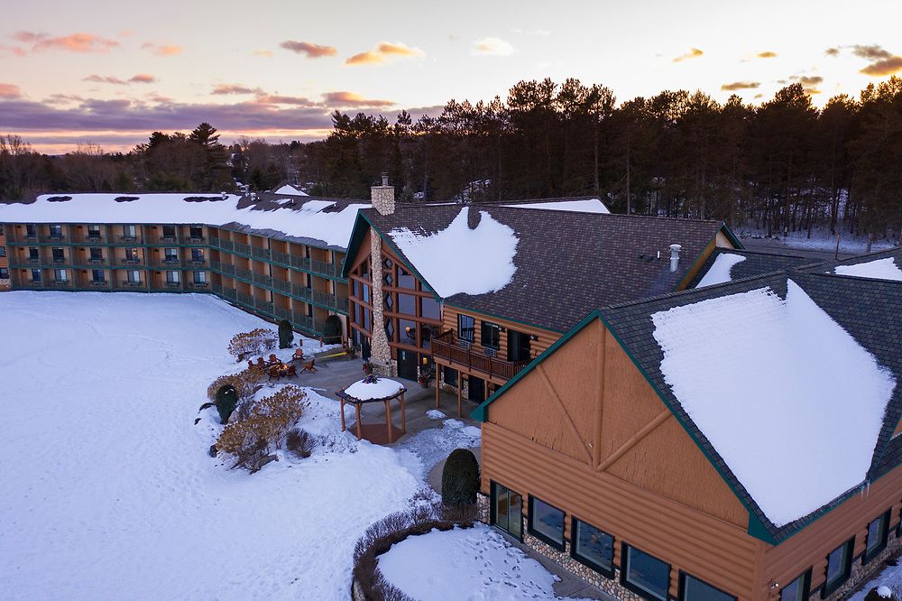 Aerial view of Stafford's Crooked River Lodge near Petoskey, Michigan in winter.