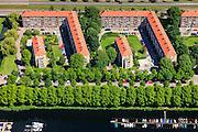 Nederland, Noord-Holland, Amsterdam, 14-06-2012; Slotervaart met Burgemeester Roellstraat. Flats gebouwd volgens ruim opgezet stratenplan. Onder in beeld Noordzijde, oever Sloterplas, met jachthaven...De wijk is onderdeel van de Westelijke Tuinsteden, gerealiseerd op basis van het Algemeen Uitbreidingsplan voor Amsterdam (AUP, 1935). Voorbeeld van het Nieuwe Bouwen, open bebouwing in stroken, langwerpige bouwblokken afgewisseld met groenstroken. .Residential district Slotervaart, one of the western garden cities of Amsterdam-west..  Constructed on the basis of the General Extension Plan for Amsterdam (AUP, 1935). Example of the New Building (het Nieuwe Bouwen), detached in strips, oblong housing blocks alternated with green areas, built in fifties and sixties of the 20th century. The recreational lake Sloterplas with marina bottom picture. luchtfoto (toeslag), aerial photo (additional fee required).foto/photo Siebe Swart