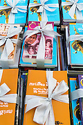 "23 APRIL 2013 - BANGKOK, THAILAND:  Some of the books being donated to Thai literacy projects during the opening ceremony to mark Bangkok as the World Book Capital City 2013. UNESCO awarded Bangkok the title. Bangkok is the 13th city to assume the title of ""World Book Capital"", taking over from Yerevan, Armenia. Bangkok Governor Suhumbhand Paribatra announced plans that the Bangkok Metropolitan Administration (BMA) intends to encourage reading among Thais. The BMA runs 37 public libraries in the city and has modernised 14 of them. It plans to build 10 more public libraries every year. Port Harcourt, Nigeria will be the next World Book Capital in 2014. .PHOTO BY JACK KURTZ"