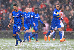 Everton's Theo Walcott shows his dejection as Stoke City equalise during the Premier League match at the bet365 Stadium, Stoke.
