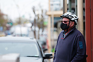A man wearing a mask stands at a crossing during COVID-19 in Kilmore, Australia. An outbreak which started in Chadstone in Melbourne, has spread as far as Benalla. Twenty-eight people linked to the outbreak have now tested positive for COVID-19. There are now two confirmed cases in Kilmore linked with a Melbourne Resident who carried the virus into the town. The person visited the Odd Fellows Cafe in Kilmore which lead to him spreading the virus to a staff member, and a customer. The cafe has been closed for deep cleaning and will remain closed until the 19th October. (Photo by Dave Hewison/Speed Media)