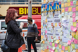 © Licensed to London News Pictures. 08/06/2017. London, UK. A woman reads messages left on a wall at London Bridge where eight people lost their lives in a terrorist attack on the evening of Saturday 3 June 2017. Photo credit: Rob Pinney/LNP