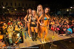Miss Lonestar bikini contestants on the main Strand stage during the Lone Star Rally. Galveston, TX. USA. Saturday November 4, 2017. Photography ©2017 Michael Lichter.