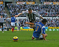 Photo: Andrew Unwin.<br /> Newcastle United v Portsmouth. The Barclays Premiership. 26/11/2006.<br /> Newcastle's James Milner (top) is fouled by Portsmouth's Dejan Stefanovic (bottom).