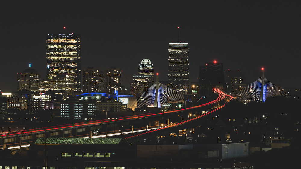 The Boston skyline seen with Route 1 traffic entering from the east.